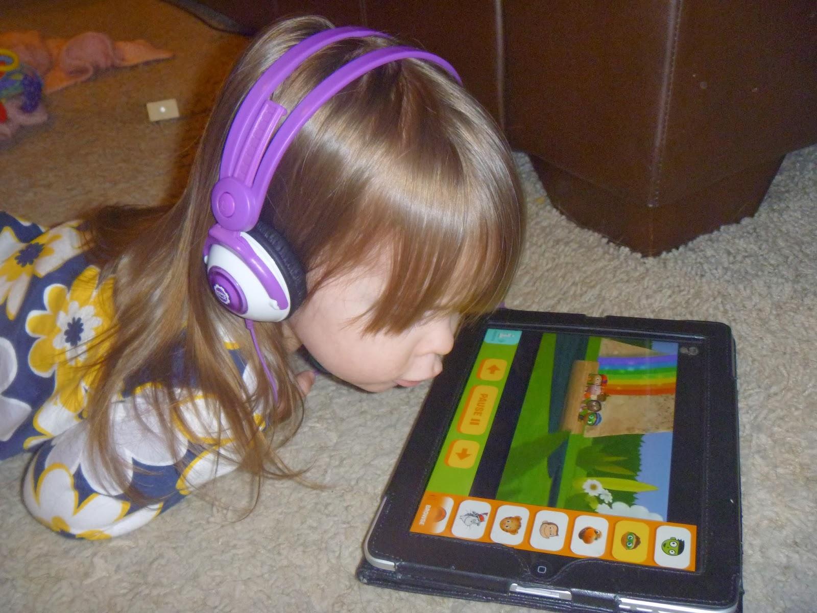 kid watching tablet