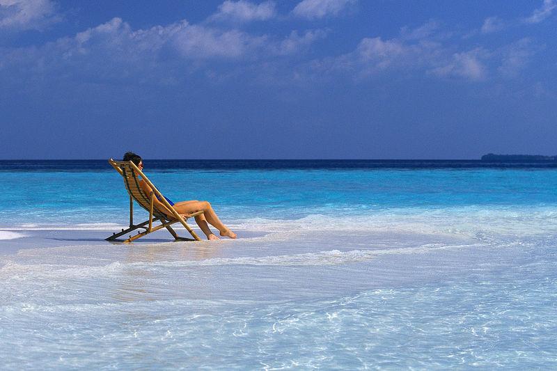 woman in a beach chair